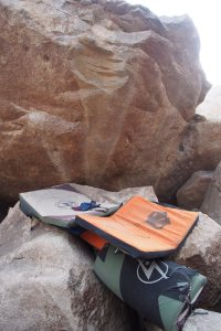 the shogun is used to bridge a wide gap above a 6 foot drop. the pad may get pushed through, but it'll still stop the climber. the orange evolv is directly over the upper last hard move
