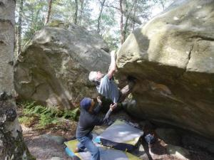 The beginning of the crux topout. Moi in action spotting.