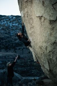 Reaching for the crux crimp/pinch on Saigon, Buttermilks.