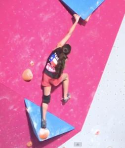 Lauren Biss reaching the undercling with her foot on the low sloper. Problem #2 Youth B Nationals.