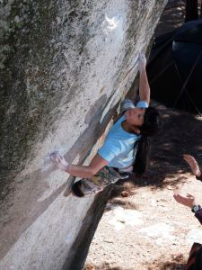Ashima Shiraishi sending Buzz Saw at the campground boulders, Black Mountain.