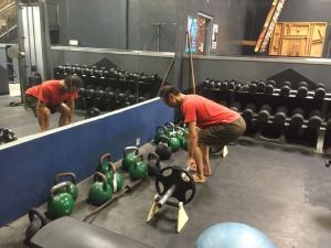 Rob working the deadlift program back at Rockreation. Since we don't have SF Iron's nice equipment, we have to be creative during our warm-ups to get the proper height with the small plates